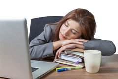 Young business woman sleeping at workplace stock photo