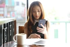 Young business woman with smartphone and coffee stock images
