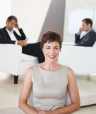 A young business woman smiling Stock Images