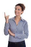 Young business woman smiling at corner pointing finger up isolat Royalty Free Stock Photos