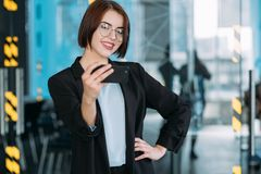 Young business woman smiling intern workspace royalty free stock image