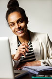Young business woman smiling with laptop Royalty Free Stock Photo