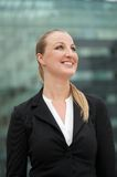 Young business woman smiling outdoors Royalty Free Stock Photography