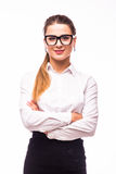 Young business woman smiling, standing with arms crossed over white background Royalty Free Stock Images