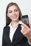 Young business woman is smiling while taking a selfie pciture Stock Image