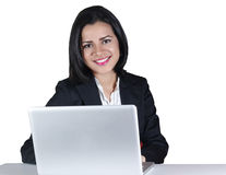 Young business woman smiling using computer Royalty Free Stock Photos