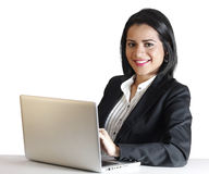 Young business woman smiling using computer Stock Photos