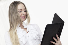 Young business woman smiling using touch pad tablet pc Royalty Free Stock Photo