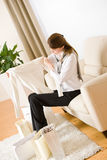 Young business woman on sofa with shopping bag Royalty Free Stock Images