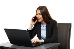 Young business woman on cellphone and laptop Royalty Free Stock Image