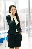 Young business woman speaking on mobile Royalty Free Stock Images