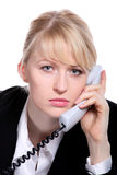 The young business woman speaks by phone. Portrait of the young business woman who were speaking by phone Royalty Free Stock Images