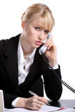 The young business woman speaks by phone. Portrait of the young business woman who were speaking by phone Stock Photo
