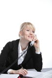 The young business woman speaks by phone. Showing to emotion Stock Photography