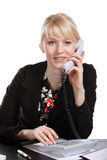 The young business woman speaks by phone. Showing to emotion Royalty Free Stock Photos