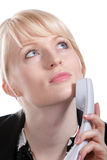 The young business woman speaks by phone. Portrait of the young business woman who were speaking by phone Royalty Free Stock Photos