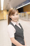 Young business woman stand in the MRT Royalty Free Stock Photography