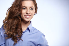 Young business woman standing against bl Royalty Free Stock Photo