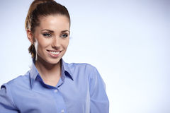 Young business woman standing against bl Royalty Free Stock Photography
