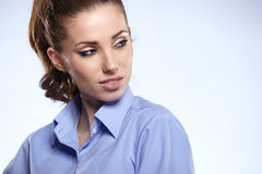 Young business woman standing against bl Royalty Free Stock Images