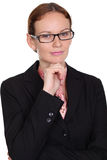 Young business woman. Standing against white background stock images