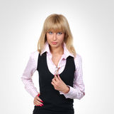 A young business woman is standing with glasses Royalty Free Stock Photography