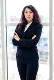 Business woman standing with hands folded Stock Photos
