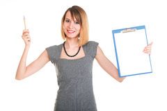Young business woman standing with her clipboard isolated Royalty Free Stock Photo