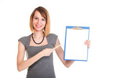 Young business woman standing with her clipboard isolated Stock Photo