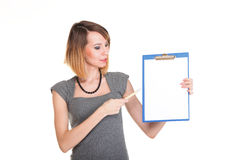 Young business woman standing with her clipboard isolated Royalty Free Stock Images