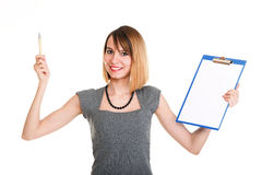 Young business woman standing with her clipboard isolated Royalty Free Stock Image