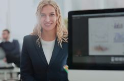Young business woman standing with her collegues in background a. Successful business woman with her staff in background at office Stock Images