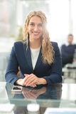 Young business woman standing with her collegues in background a Stock Photos