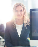 Young business woman standing with her collegues in background a Royalty Free Stock Photography
