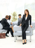 Young business woman standing with her collegues in background a Royalty Free Stock Photos