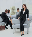 Young business woman standing with her collegues in background a Royalty Free Stock Image