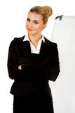 Young business woman standing nex to the white board Royalty Free Stock Photo