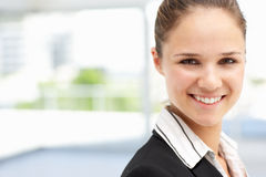 Young business woman standing in office Royalty Free Stock Photos