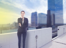 Young business woman standing with office skyline stock photo