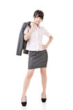 Young business woman standing pensive Royalty Free Stock Photography