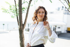 Young business woman standing on the street stock photography