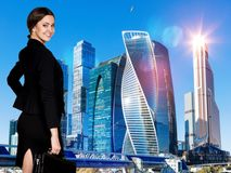 Business woman stands over cityscape background. royalty free stock images