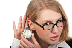 Young business woman with stopwatch Royalty Free Stock Image