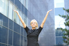 A young business woman is stretching her hand up Stock Photos