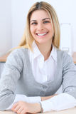 Young business woman or student girl sitting at office workplace with laptop computer. Home business concept Stock Photos
