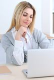 Young business woman or student girl sitting at office workplace with laptop computer. Home business concept Stock Photography