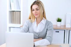 Young business woman or student girl sitting at office workplace with laptop computer. Home business concept royalty free stock images