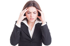 Young business woman suffering head pain or migraine Royalty Free Stock Photos