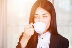 Business woman in suit drinking coffee or tea cup Stock Photos