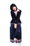 Young business woman and suitcase Stock Photo